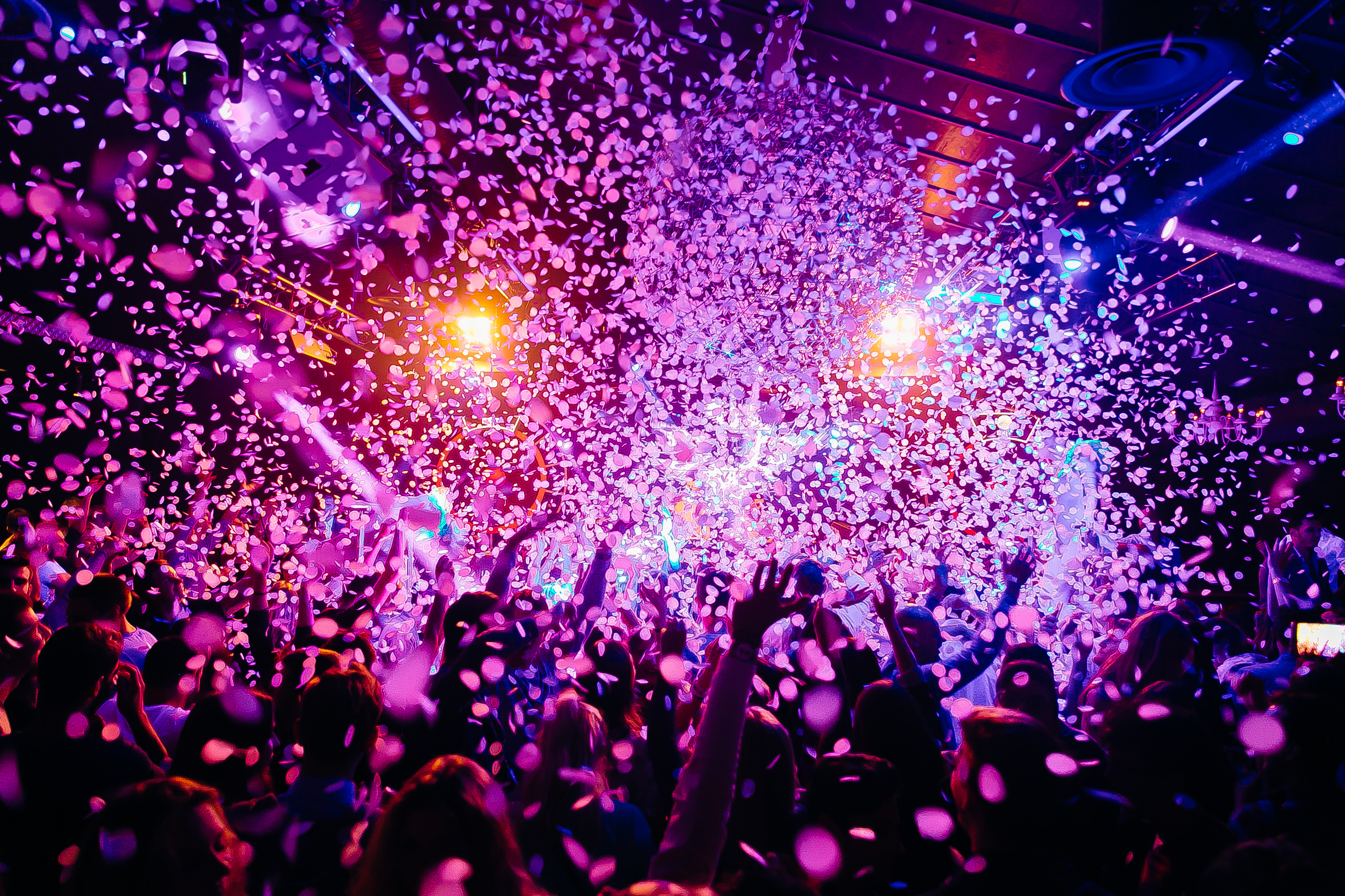 Entertainment Risk Concert crowd - picture with a lof of people dancing i a concert, night club with raised their hands up! Amazing colours!